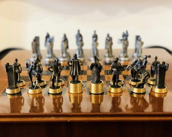 Chess pieces average age of tin with gold and silver