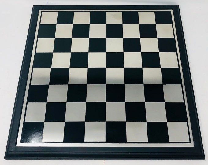 Metal chessboard with wooden frame