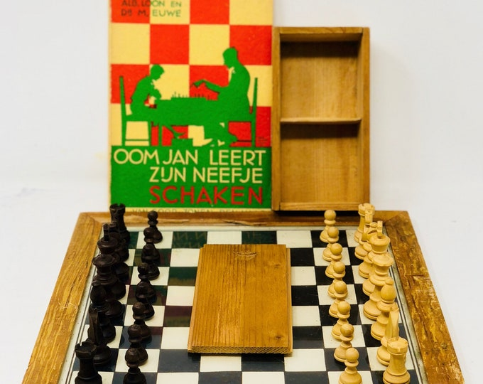 Old chess with board and book