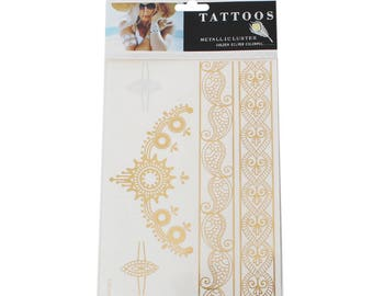 Tattoos gold and silver, chain and oriental pattern.