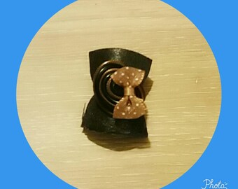 black and Brown ring with a bow
