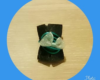 black and blue ring with a bow
