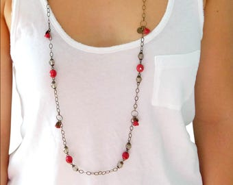 Bronze necklace in shades of red and taupe.