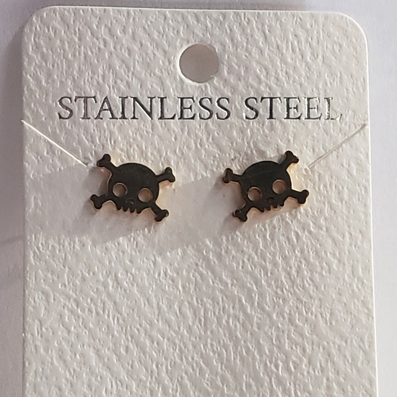 great for Halloween stainless steel Skull and crossbones earring set available in silver and gold