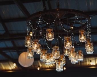 Mason jar chandelier etsy wagon wheel mason jar chandelier aloadofball Gallery