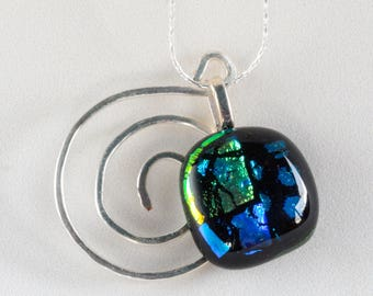 """Stunning glass pendant (1""""),blue green dichroic fused glass with a hammered silver accent.  Hangs on a silver necklace. #182"""