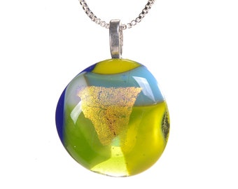 """Beautiful dichroic glass pendant, with gold dichroic with yellow blue and clear glass. Necklace hangs on 18"""" silver chain. Fused glass. 308"""