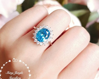 Royal Halo style Swiss blue topaz engagement ring, 3 carats oval cut blue topaz promise engagement ring, white gold plated sterling silver