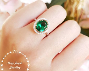Halo oval cut emerald engagement ring, vivid green emerald ring, green gemstone ring, cluster ring, white gold plated silver, May Birthstone