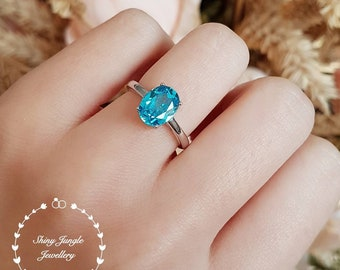 Oval Swiss blue topaz ring, 2.5 ct lab blue topaz engagement ring, white gold plated sterling silver, blue gemstone ring, oval blue ring