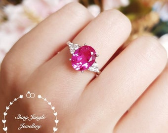 Oval pink sapphire engagement ring, September birthstone promise ring, three stone style ring, white gold plated silver, pink gemstone ring