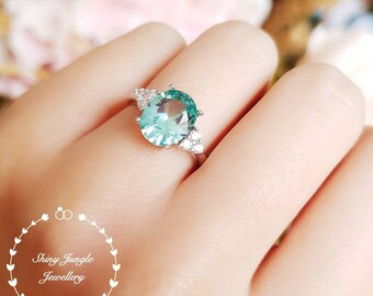 Paraiba tourmaline ring, green tourmaline ring, three stone Paraiba tourmaline ring, white gold plated sterling silver, oval cut teal ring
