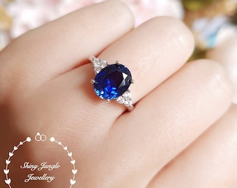 Royal Blue sapphire engagement ring, 3 carats oval cut lab sapphire, three stone ring, white gold plated sterling silver, statement ring