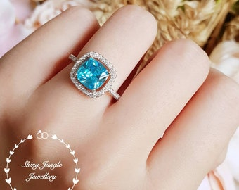 Halo Swiss blue topaz ring, lab blue topaz engagement ring, white gold plated sterling silver, blue gemstone ring, cushion cut topaz ring