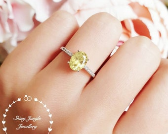 Yellow diamond ring, engagement ring, 1.5 carats oval cut fancy yellow diamond ring, pastel yellow ring, yellow diamond solitaire ring