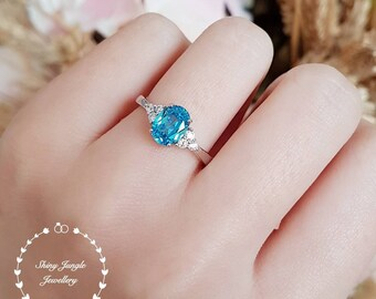 Oval Swiss blue topaz ring, 1.5 ct lab blue topaz engagement ring, white gold plated sterling silver, blue gemstone ring, aquamarine ring