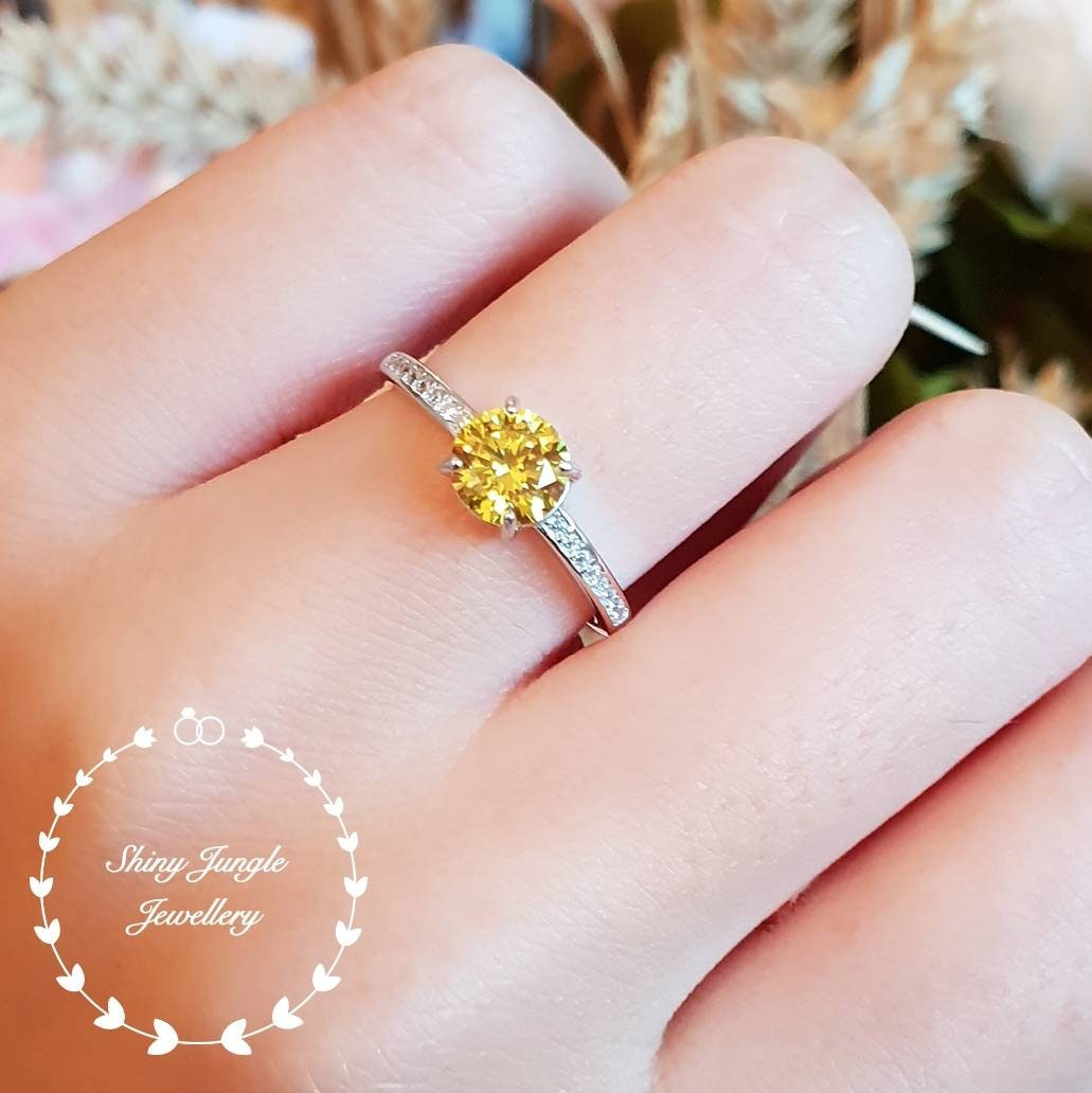 bbb31edfb86e3 Round Yellow diamond engagement ring, delicate 1 carat fancy yellow ...