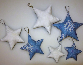 6 blue and white stars fabric has to suspend from the Christmas tree