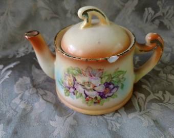 Vintage Czechoslovakian lustreware teapot, floral design.