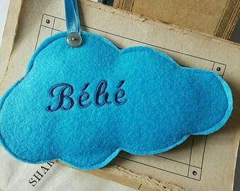 Door embroidered baby blue felt cloud cushion