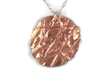 Fold formed copper disc pendant