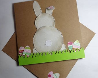 Easter card - In the grass with eggs Easter Bunny