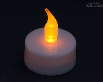 LED tea light with yellow flickering flame