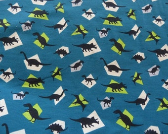 Blue Jersey with patterns of dinosaurs in 150 cm, sold by the yard