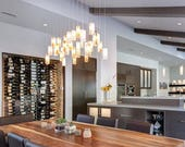 Kitchen island lighting or, this modern light fixture, is elegant yet cozy