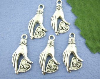 2 charms/pendants hand and heart in antique silver