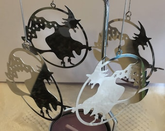 Witches on brooms Spinning Tealight Holders