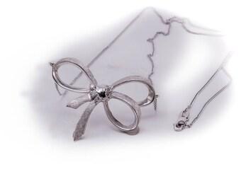Vintage white gold diamond bow necklace, circa 1970
