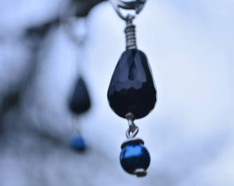 Silver earring with onyx and hematite