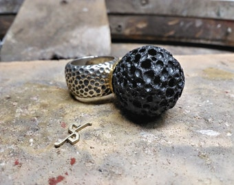 Silver ring with black lava ball