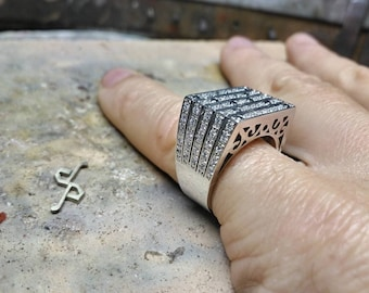 White gold ring with black and white diamonds