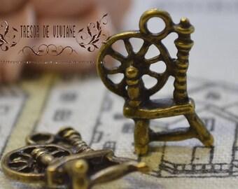 set of 10 QKA041 Spinning wheel, sewing, bronze