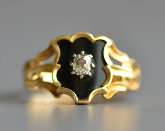 Antique Georgian Era cushion old mine cut diamond and black enamel mourning ring in 18k gold shield shape