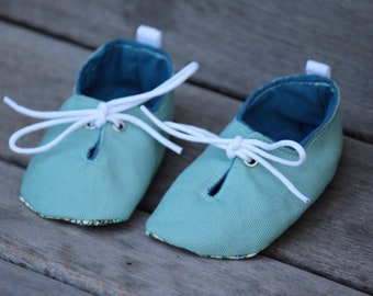389690351c12 Aqua blue baby shoes with peacock pattern soles