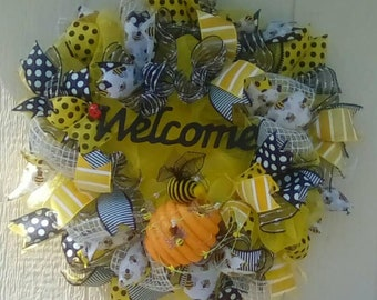 Bee Welcome.  This ray of sunshine will brighten any door.  Classic black and yellow buzzzy bee and honey comb.