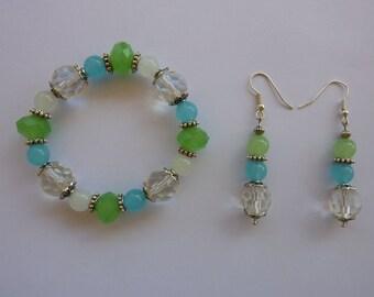 bracelet and earrings ' ear