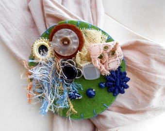 textile brooch green blue and beige