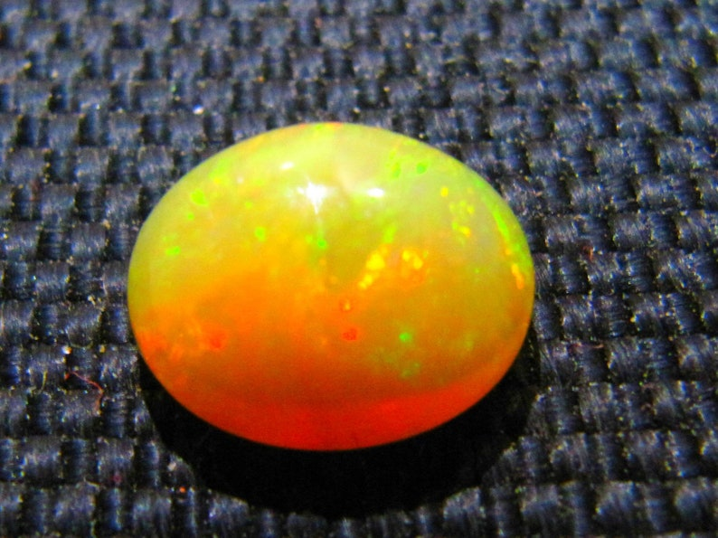 10\u00d711 mm oval natural Ethiopian opal gemstones cabochon calibrated loose opal stone 1 piece multi flashy fire opal   opal cabochon opal