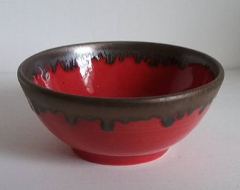 Small handmade red and gold bowl