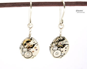 Pair of silver pendant earrings with seiko watch mechanisms with eye rubies art.227