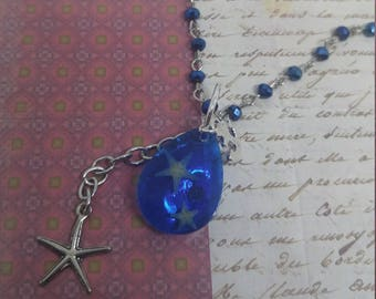 A Drop in the Ocean - handmade pendant necklace with blue teardrop resin sea piece, nautical charms and blue gem chain