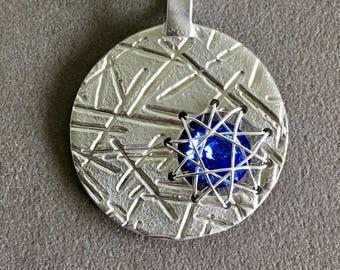 Pendant with blue Rivoli stone