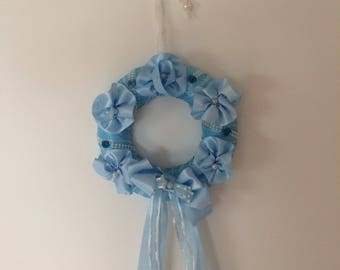 Wreath ornament in blue satin