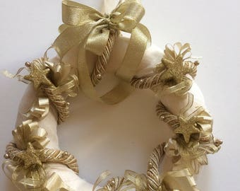Christmas or new year, beige and gold wreath