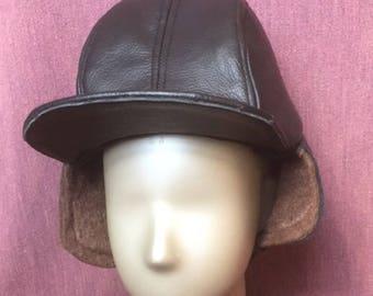 Black leather brown faux fur winter hat