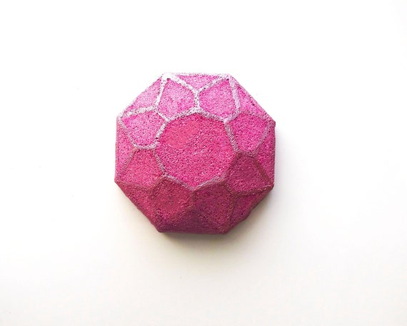 This is a gem of a bath bomb, an adventurous take on a traditional rose scent. With rose petals leading the way, a bright and unique blend of bergamot, orange zest, jasmine, and grapefruit, and undertones of sandalwood and musk.  This 4.5 oz bath bomb will turn the water into a deep